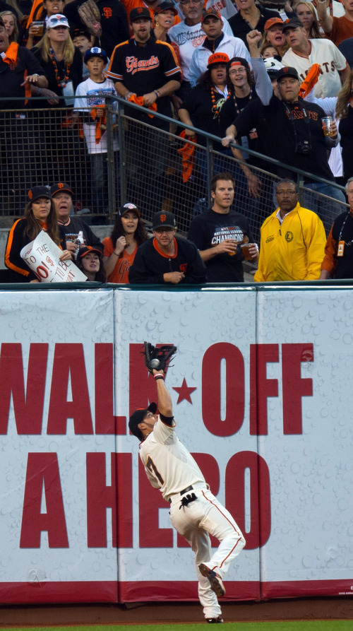 San Francisco Giants right fielder Gregor Blanco (7) catches a fly off the bat of Detroit Tigers' Prince Fielder (28) during the fourth inning of Game 2 of baseball's World Series, Thursday, Oct. 25, 2012, in San Francisco. (AP Photo/The Sacramento Bee, Jose Luis Villegas)  MAGS OUT; LOCAL TV OUT (KCRA3, KXTV10, KOVR13, KUVS19, KMAZ31, KTXL40); MANDATORY CREDIT