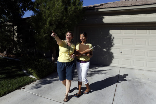 Utah republicans Juleen Jackson left, and her daughter Mary Alice Jackson canvas homes on Saturday, Oct. 20, 2012 in Las Vegas. (Isaac Brekken for the Salt Lake Tribune)