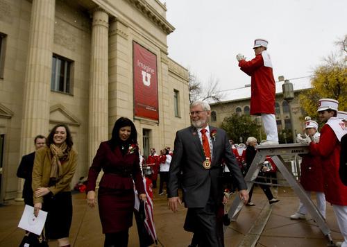Kim Raff | The Salt Lake Tribune The 15th University of Utah president, David Pershing, walks out of his inauguration to the University of Utah marching band outside of Kingsbury Hall in Salt Lake City on Thursday, October 25, 2012.