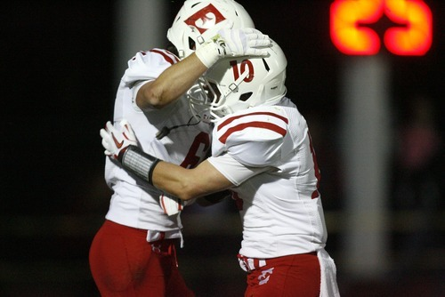 Kim Raff | The Salt Lake Tribune East High players (left) Zach Swenson and Preston Curtis celebrate Swenson's touchdown against Bountiful High School at Bountiful High School in Bountiful, Utah on October 5, 2012.