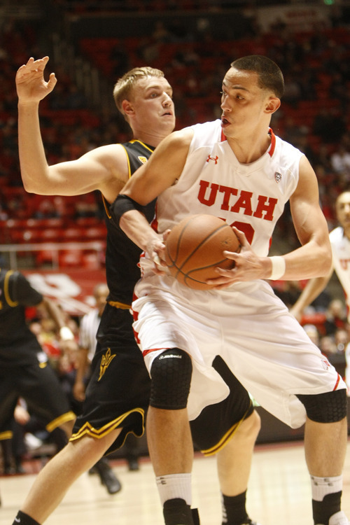 Chris Detrick  |  The Salt Lake Tribune Utah Utes center Jason Washburn (42) is guarded by Arizona State Sun Devils forward Jonathan Gilling (31) during the first half of the game at the Huntsman Center Saturday January 21, 2012. Utah is winning the game 38-21.