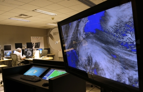 A satellite image of Hurricane Sandy is shown on a computer screen at the National Hurricane Center in Miami on Friday, Oct. 26, 2012. Sandy left 21 people dead as it moved through the Caribbean, following a path that could see it blend with a winter storm and reach the U.S. East Coast as a super-storm next week. (AP Photo/Lynne Sladky)