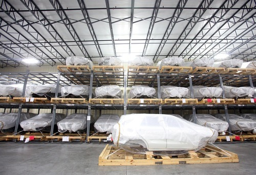 FILE - In this Monday, Aug. 13, 2012 file photo, Mercedes SUV bodies are seen during a tour of the SKD packaging facility at BLG Logistics, Inc. in Vance, Ala. The U.S. economy grew at a slightly faster 2 percent annual rate from July through September, buoyed by more spending by consumers and the federal government, the Commerce Department said Friday, Oct. 26, 2012. Growth accelerated from the 1.3 percent rate in the April-June quarter. (AP Photo/Tuscaloosa News, Dusty Compton, File)