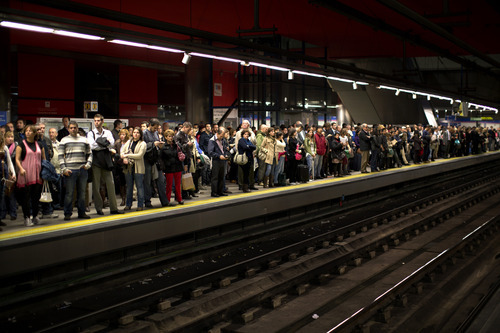 Passengers are waiting for their train at the Madrid underground in Spain, Friday, Oct. 26, 2012. Spain's National Statistics Institute says the country's unemployment rate rose around 0.4 percentage points in the third quarter on the previous three months to 25 percent. The institute says Friday 85,000 people more joined the ranks of the unemployed between July and September, taking the total to 5.78 million. (AP Photo/Emilio Morenatti)