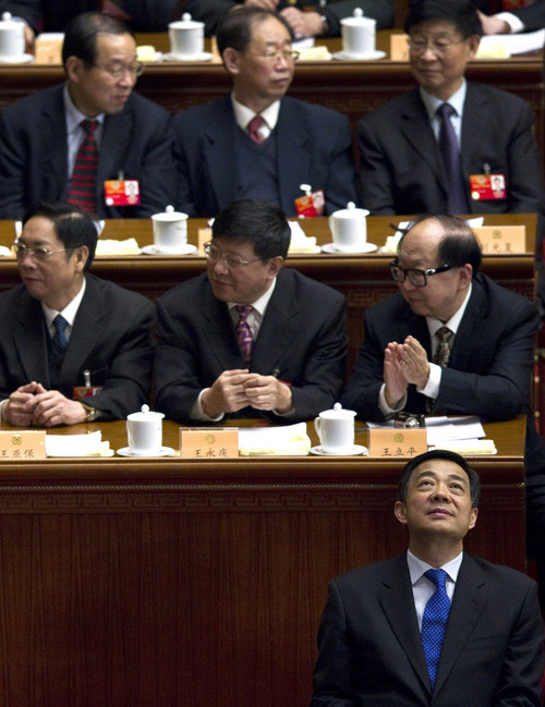 FILE - In this March 13, 2012 file photo, then-Chongqing party secretary Bo Xilai, front row, attends the closing session of the Chinese People's Political Consultative Conference at the Great Hall of the People in Beijing.  Chinese lawmakers stripped disgraced politician Bo Xilai of his last official position Friday, Oct. 26, 2012,  formally expelling him from the country's top legislature and setting the stage for criminal proceedings against the once-rising political star. (AP Photo/Alexander F. Yuan, File)