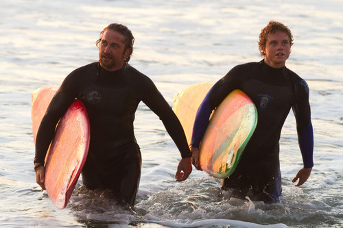 This film image released by Twentieth Century Fox shows Gerard Butler, left, and Jonny Weston in a scene from