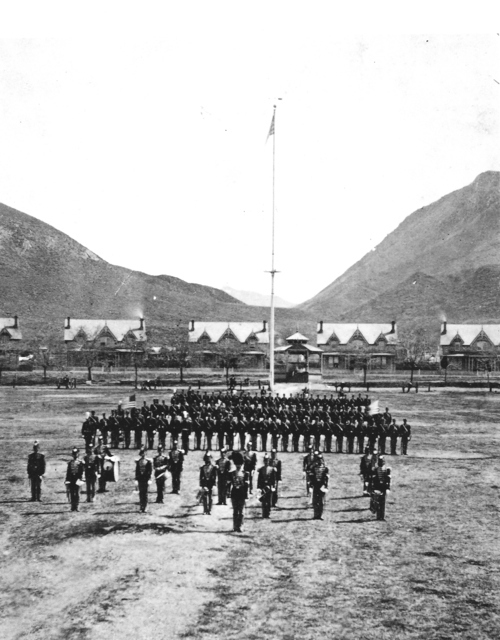 Soldiers stand at attention on the parade field at Fort Douglas, 150 years old this month. The University of Utah now controls this part of the historic fort, including the Gothic Rival-style buildings in the rear, once part of Officer's Circle. Photo courtesy of Fort Douglas Museum.