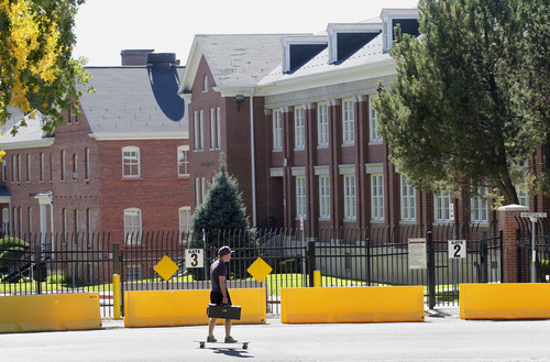 Al Hartmann  |  The Salt Lake Tribune A University of Utah student rides his skateboard along Hempstead Road on today's much smaller version of Fort Douglas.