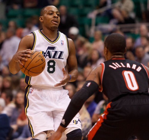 Trent Nelson  |  The Salt Lake Tribune Utah Jazz guard Randy Foye (8) controls the ball as the Utah Jazz host the Portland Trailblazers in preseason NBA basketball Thursday October 25, 2012 at EnergySolutions Arena in Salt Lake City, Utah.