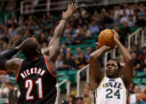 Trent Nelson  |  The Salt Lake Tribune Utah Jazz forward Paul Millsap (24) shoots over Portland's JJ Hickson (21) as the Utah Jazz host the Portland Trailblazers in preseason NBA basketball Thursday October 25, 2012 at EnergySolutions Arena in Salt Lake City, Utah.