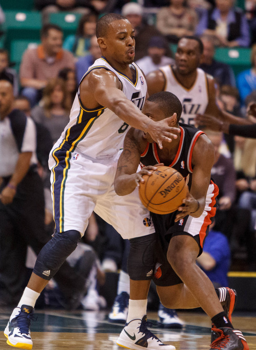 Trent Nelson  |  The Salt Lake Tribune Utah Jazz guard Randy Foye (8) defending Portland's Damian Lillard (0) as the Utah Jazz host the Portland Trailblazers in preseason NBA basketball Thursday October 25, 2012 at EnergySolutions Arena in Salt Lake City, Utah.
