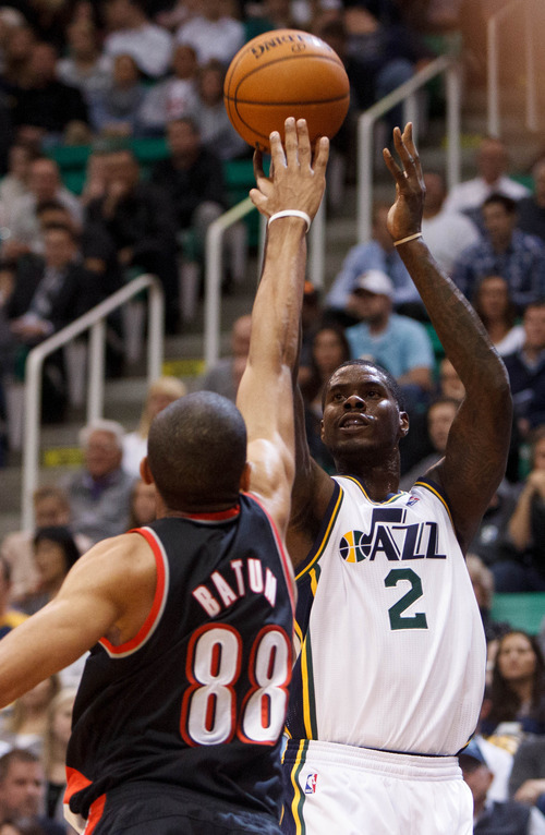 Trent Nelson  |  The Salt Lake Tribune Utah Jazz forward Marvin Williams (2) shoots over Portland's Nicolas Batum (88) as the Utah Jazz host the Portland Trailblazers in preseason NBA basketball Thursday October 25, 2012 at EnergySolutions Arena in Salt Lake City, Utah.
