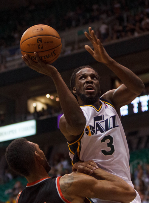 Trent Nelson  |  The Salt Lake Tribune Utah Jazz's Demarre Carroll (3) shoots the ball over Portland's Jared Jeffries (1) as the Utah Jazz host the Portland Trailblazers in preseason NBA basketball Thursday October 25, 2012 at EnergySolutions Arena in Salt Lake City, Utah.