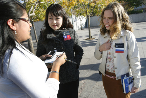 Scott Sommerdorf  |  The Salt Lake Tribune              Sister He, left, a missionary from China and Sister Sazonova, a fellow LDS missionary from Russia, speak to a woman about the church outside the 182nd Semiannual General Conference, Saturday, Oct. 6, 2012.