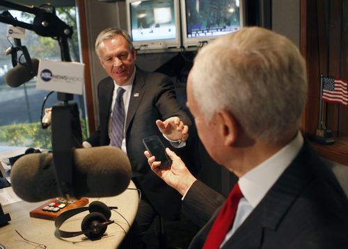 Al Hartmann  |  The Salt Lake Tribune Democrat Scott Howell, left, asks to see Republican Sen. Orrin Hatch's new iphone 5 before their second and final debate on KSL Radio's Doug Wright show Friday.