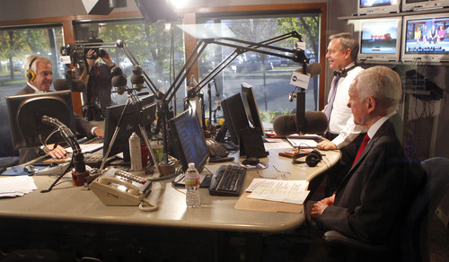Al Hartmann  |  The Salt Lake Tribune KSL Radio's Doug Wright, left, moderates final debate between Democrat Scott Howell  and Republican Senator Orrin Hatch Friday Ocotber 26.