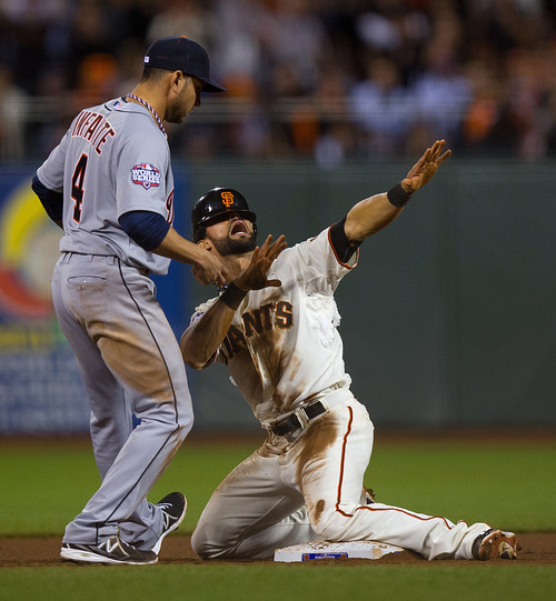 San Francisco Giants' Angel Pagan signals for time after stealing second in the eighth inning against the Detroit Tigers during Game 2 of baseball's World Series, Thursday, Oct. 25, 2012, in San Francisco. At left is Tigers' Omar Infante. The Giants won 2-0. (AP Photo/The Sacramento Bee, Jose Luis Villegas) MAGS OUT; TV OUT (KCRA3, KXTV10, KOVR13, KUVS19, KMAZ31, KTXL40) MANDATORY CREDIT