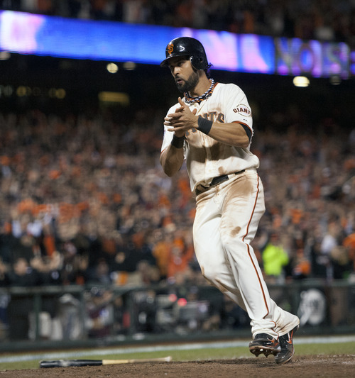 San Francisco Giants' Angel Pagan applauds as he scores in the eighth inning agains the Detroit Tigers in Game 2 of baseball's World Series, Thursday, Oct. 25, 2012, in San Francisco. The Giants won 2-0. (AP Photo/The Sacramento Bee, Paul Kitagaki Jr.) MAGS OUT; TV OUT (KCRA3, KXTV10, KOVR13, KUVS19, KMAZ31, KTXL40) MANDATORY CREDIT
