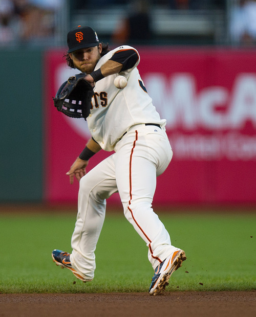San Francisco Giants shortstop Brandon Crawford bobbles a single by Detroit Tigers' Omar Infante during the fourth inning in Game 2 of baseball's World Series, Thursday, Oct. 25, 2012, in San Francisco. (AP Photo/The Sacramento Bee, Jose Luis Villegas) MAGS OUT; TV OUT (KCRA3, KXTV10, KOVR13, KUVS19, KMAZ31, KTXL40) MANDATORY CREDIT