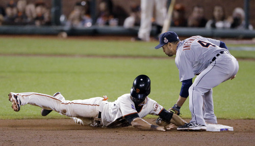 San Francisco Giants' Angel Pagan is safe at second on a steal as Detroit Tigers' Omar Infante attempts to tag during the eighth inning of Game 2 of baseball's World Series Thursday, Oct. 25, 2012, in San Francisco. (AP Photo/Charlie Riedel)