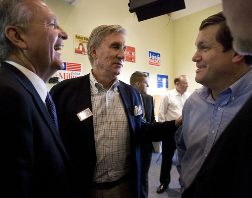 Scott Sommerdorf  |  The Salt Lake Tribune               Peter Cooke, center, running for Governor of Utah speaks with fellow Democratic candidates Scott Howell, left, and Dee Smith, right, at the Democratic State headquarters, Friday, October 26, 2012.