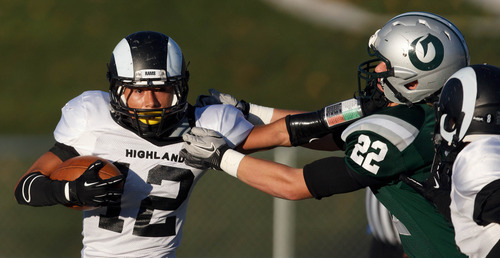 Trent Nelson  |  The Salt Lake Tribune Highland's Jerry Padilla stiff-arms Olympus's Ben Seagle. Olympus vs. Highland, 4A high school football playoffs Friday October 26, 2012 at Olympus High School in Salt Lake City, Utah.