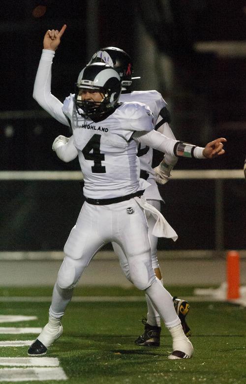 Trent Nelson  |  The Salt Lake Tribune Highland's Austin Peterson celebrates Adam Webber's game-winning touchdown. Olympus vs. Highland high school football Friday October 26, 2012 in Salt Lake City, Utah.