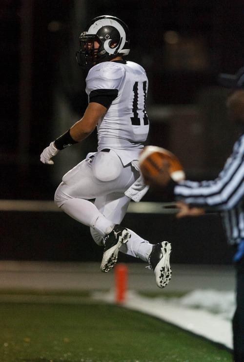 Trent Nelson  |  The Salt Lake Tribune Adam Webber celebrates his game-winning touchdown. Olympus vs. Highland high school football Friday October 26, 2012 in Salt Lake City, Utah.