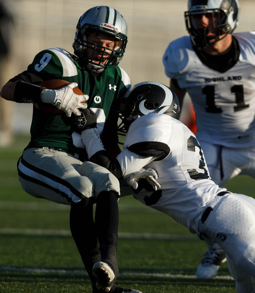 Trent Nelson  |  The Salt Lake Tribune Olympus's Nate Mayer is brought down by Highland's Nolen Groesbeck. Olympus vs. Highland, 4A high school football playoffs Friday October 26, 2012 at Olympus High School in Salt Lake City, Utah.