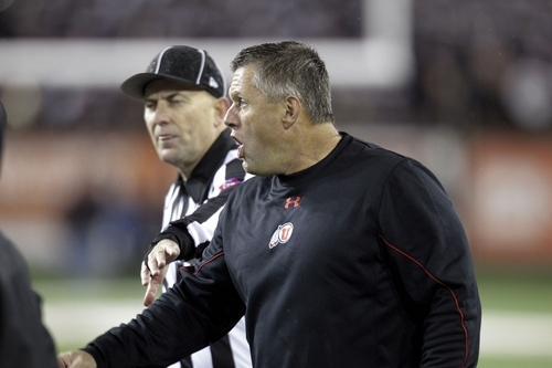 Utah football coach Kyle Whittingham, right, argues with a referee during the second half of their NCAA college football game against Oregon State in Corvallis, Ore., Saturday, Oct. 20, 2012. (AP Photo/Don Ryan)