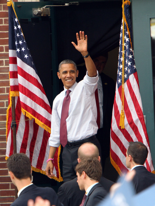 President Barack Obama waves as he leaves a campaign event at Elm Street Middle School, Saturday, Oct. 27, 2012 in Nashua, N.H.  (AP Photo/Jim Cole)