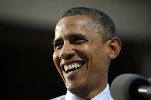 President Barack Obama smiles as he speaks to supporters at a campaign event at Elm Street Middle School, Saturday, Oct. 27, 2012 in Nashua, N.H. (AP Photo/Pablo Martinez Monsivais)