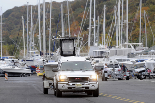 As Hurricane Sandy moves up the East Coast, owners remove their boats from the water at the Atlantic Highlands Marina, Friday Oct. 26, 2012 in Atlantic Highlands, N.J. When Hurricane Sandy becomes a hybrid weather monster some call