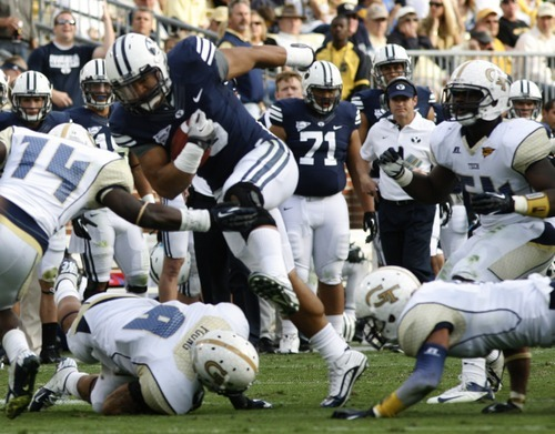 Rick Egan  | The Salt Lake Tribune   Brigham Young running back Iona Pritchard (5) gets past Georgia Tech Yellow Jackets cornerback Louis Young (8) in football action BYU vs Georgia Tech, at Bobby Dodd Stadium in Atlanta, Saturday, October 27, 2012