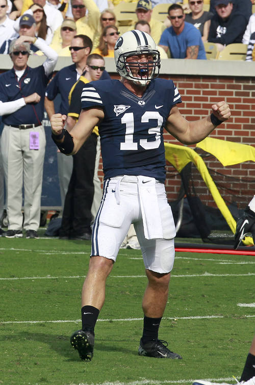 Bringham Young quarterback Riley Nelson (13) reacts after a touchdown in the first half of an NCAA college football game against Georgia Tech in Atlanta, Saturday, Oct. 27, 2012. (AP Photo/John Bazemore)