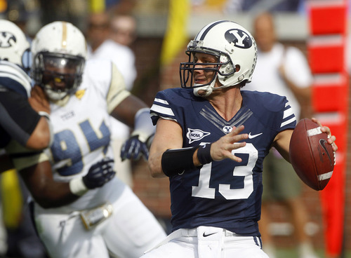 Brigham Young quarterback Riley Nelson (13) throws from the pocket in the first half of an NCAA college football game against Georgia Tech in Atlanta, Saturday, Oct. 27, 2012. (AP Photo/John Bazemore)
