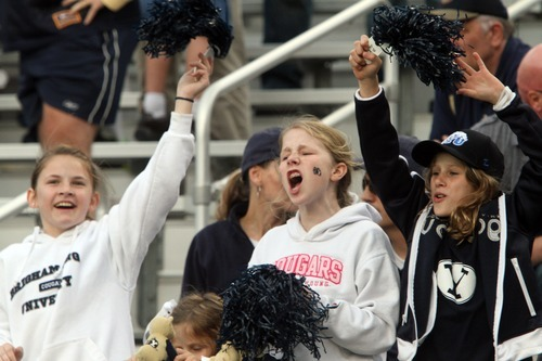 Rick Egan    The Salt Lake Tribune   Twelve-year-old BYU fans Autumn Dustin (left) Chandler Hatch (center) and Lauren Hatch,  from Canton, Georgia, cheer for the Cougars, as BYU faced Georgia Tech, at Bobby Dodd Stadium in Atlanta, Saturday, October 27, 2012
