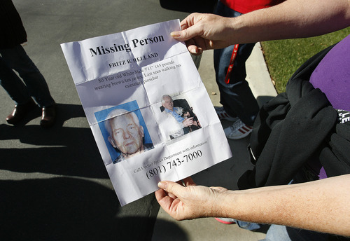 Scott Sommerdorf     The Salt Lake Tribune               Volunteers study the flyer showing photos of missing 80 year old Fritz Helland, and his dog, Sunday, October 28, 2012.