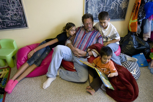 Kim Raff | The Salt Lake Tribune Rich Larson hangs out with his kids during reading time in their home in Layton, Utah, on October 24, 2012. Richard and his wife Happie adopted 15 children from foster care. She was able to get a tax credit that eased adoption expenses for four of the children. That tax credit will expire at the end of the year.