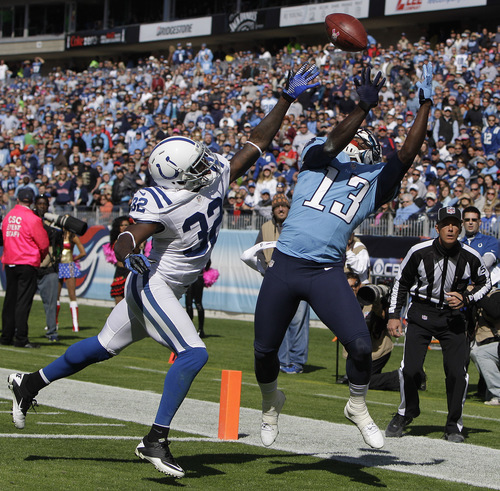 Tennessee Titans wide receiver Kendall Wright (13) makes a touchdown catch against Indianapolis Colts cornerback Cassius Vaughn (32) during the first half of an NFL football game Sunday, Oct. 28, 2012, in Nashville, Tenn. (AP Photo/Wade Payne)