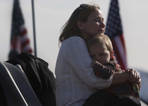 Leah Hogsten  |  The Salt Lake Tribune Mary-Jane Hughes of Ft. Walton Beach, FL hugs her grandson Noah DeKorver as she pays tribute to her husband Sr. Airman Derek Hughes Saturday, October 26, 2012 who lost his life in the crash. Twenty years ago on Monday October 29, 1992, 12 Army Rangers and Air Force special operations troops perished in a helicopter crash just north of Antelope Island. On Saturday, their families, friends and those who helped with the rescue and recovery celebrated their memory with a rededication of a monument on Antelope Island. The crash of the Air Force MH-60G Pave Hawk helicopter, was the last chopper in a four-helicopter formation that was carrying Army and Air Force special operations troops from HAFB to the Army's Dugway Proving Ground as part of a training exercise.