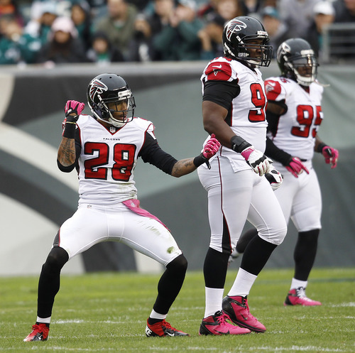 Atlanta Falcons free safety Thomas DeCoud (28) reacts after a play against the Philadelphia Eagles during the first half of an NFL football game, Sunday, Oct. 28, 2012, in Philadelphia. (AP Photo/Mel Evans)
