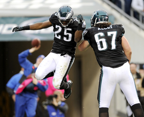 Philadelphia Eagles running back LeSean McCoy (25) and tackle Dennis Kelly (67) react after McCoy scored on a two-yard run during the first half of an NFL football game against the Atlanta Falcons, Sunday, Oct. 28, 2012, in Philadelphia. (AP Photo/Michael Perez)