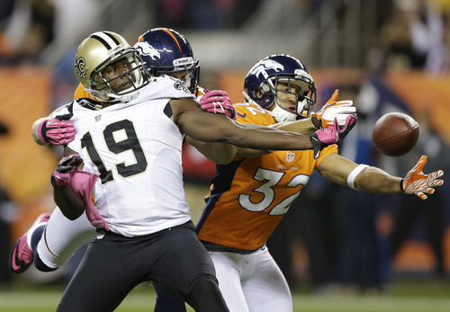 Denver Broncos free safety Jim Leonhard (36) and defensive back Tony Carter (32) break up a pass intended for New Orleans Saints wide receiver Devery Henderson (19) in the first quarter of an NFL football game, Sunday, Oct. 28, 2012, in Denver. (AP Photo/Jack Dempsey)