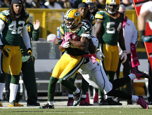 Green Bay Packers Randall Cobb is tackled by Jacksonville Jaguars Chris Harris during the second half of an NFL football game Sunday, Oct. 28, 2012, in Green Bay, Wis. (AP Photo/Tom Lynn)