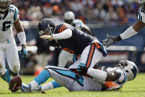 Carolina Panthers defensive tackle Frank Kearse (99) forces Chicago Bears quarterback Jay Cutler (6) to fumble during the first half of an NFL football game in Chicago, Sunday, Oct. 28, 2012. (AP Photo/Nam Y. Huh)