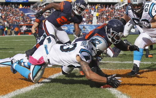 Carolina Panthers wide receiver Louis Murphy (83) recovers a fumble in the end zone for a touchdown against the Chicago Bears during the first half of an NFL football game in Chicago, Sunday, Oct. 28, 2012. Ther ball was fumbled by Panthers quarterback Cam Newton. (AP Photo/Charles Rex Arbogast)