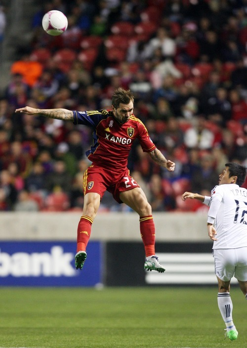 Kim Raff | The Salt Lake Tribune Real Salt Lake midfielder Jonny Steele (22) heads the ball over Vancouver FC defender Young-Pyo Lee (12) during a game at Rio Tinto Stadium in Sandy, Utah on October 27, 2012.