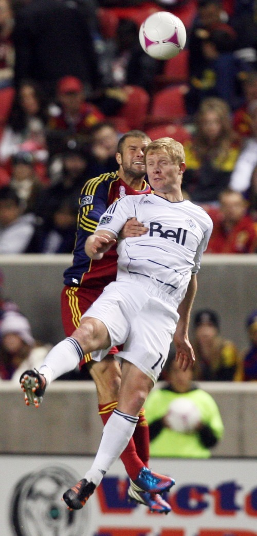 Kim Raff | The Salt Lake Tribune (left) Real Salt Lake defender Chris Wingert (17) tries to get a head on the ball with Vancouver FC midfielder Barry Robson (14) during a regular season game at Rio Tinto Stadium in Sandy, Utah on October 27, 2012.