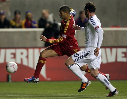 Kim Raff | The Salt Lake Tribune (left) Real Salt Lake forward Alvaro Saborio (15) dribbles down field as he is defended by Vancouver FC Defender Andy O'Brien during a game at Rio Tinto Stadium in Sandy, Utah on October 27, 2012.